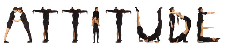 Black dressed people forming word ATTITUDE. On white background stock images
