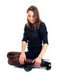 Black dressed sitting female. Black dressed fashion female sits isolated on white Royalty Free Stock Image