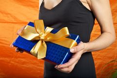 Black dressed woman blue gift Royalty Free Stock Image