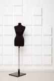 Black dressmaker's dummy in the studio Royalty Free Stock Photo