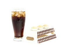 Black drink (cola) and sugar over lettuce over white background Stock Photos