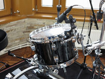 Black drum kit, cables and microphones closeup Stock Photo