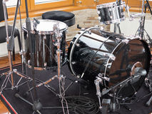 Black drum kit, cables and microphones closeup Royalty Free Stock Photography