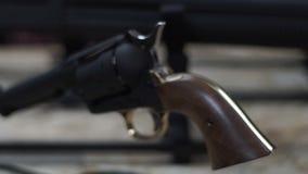 Black drum revolver with a wooden handle. Weapon pistol. Black handgun. stock video