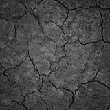 Black Dry Drought Land with Chaps. As Natural Ground Background royalty free stock photo