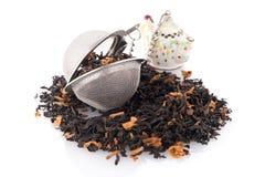 Black dry tea with petals Stock Image