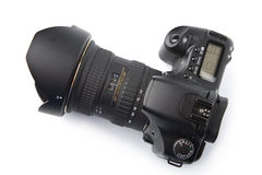 Black DSLR camera isolated Stock Images