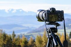 Black Dslr Camera Mounted on Black Tripod Royalty Free Stock Photo