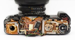 Black Dslr Camera Showing Its Circuit Board Stock Photos