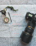 Black Dslr Camera on White and Blue Map Royalty Free Stock Photography