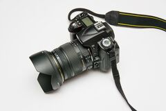 Black Dslr Camera on White Surface Royalty Free Stock Photos