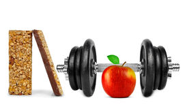 Black dumbbell with apple and muesli bars Stock Photography
