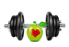 Black dumbbell with apple Royalty Free Stock Photography
