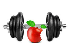 Black dumbbell with apple Royalty Free Stock Image