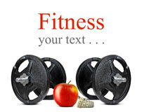 Black dumbbells with apple and measuring tape Stock Image