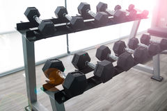 Black dumbbells in fitness center, Sport club Stock Photography