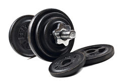 Black dumbbells and loose weights Stock Photography