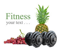 Black dumbbells with pineapple and grapes Stock Photo