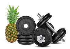 Black dumbbells with pineapple Royalty Free Stock Photo