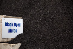 Black dyed mulch. Bulk pile of black dyed mulch used for landscaping projects stock photos