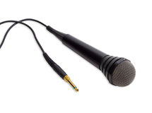 Black dynamic microphone on a light background Royalty Free Stock Photo