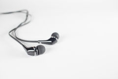 Black ear phone on a white background. Stock Photo