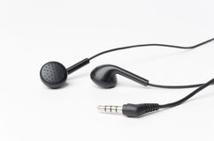 Music Earbuds. Black earbuds isolated on a white background Stock Photos