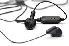 Black earphone. Royalty Free Stock Photography