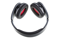 Black earphones with black and red padding. Isolated on white Royalty Free Stock Photography