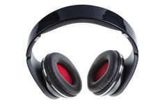 Black earphones with black and red padding Stock Image
