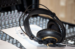 Black earphones on a console in a recording studio Stock Photography
