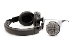 Black earphones and microphone Royalty Free Stock Photo