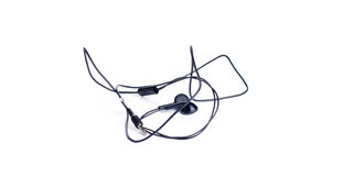 Black earphones on a white background Royalty Free Stock Photos