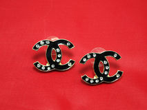 Black Earrings with isolated on red Royalty Free Stock Image