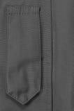 Black ECWCS Parka Rank Insignia Badge Loop Closeup, Blank Empty Vertical Apparel Background Copy Space, Front Placket Storm Flap Stock Photo