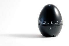 Black egg timer. An  shot of a kitchen black egg timer Royalty Free Stock Photography