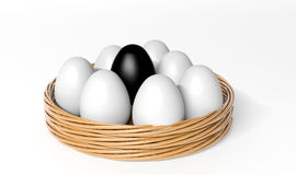 Black egg among white eggs Royalty Free Stock Photos