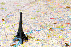 Eiffel tower paris map. Black Eiffel tower over the map of Paris Royalty Free Stock Images