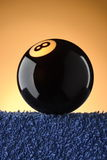Black Eight Pool Ball. On the edge Royalty Free Stock Photography