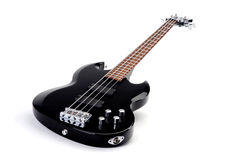 Black electric bass guitar. Lying on side, white studio background Stock Image