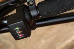 Black electric bike handle close up Royalty Free Stock Photo