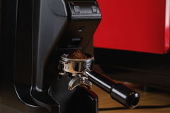 Black electric grinder is on a wooden table. Professional black electric grinder is on a wooden table Stock Image