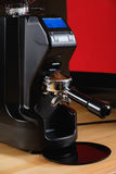 Black electric grinder is on a wooden table. Professional black electric grinder is on a wooden table Royalty Free Stock Photography