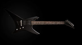 Black electric guitar. Black heavy metal electric guitar on black background Stock Photo