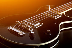 Black electric guitar. Black electric guitar cloze up Royalty Free Stock Images