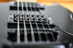 Black electric guitar, details of pills royalty free stock photos