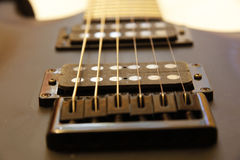 Black electric guitar  on the white backgriund Royalty Free Stock Photos