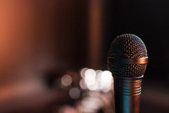 Black electric microphone on empty stage Royalty Free Stock Images