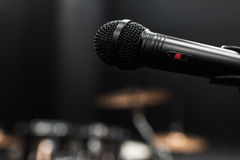 Black electric microphone on empty stage Stock Photo