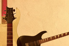 Black electric rock guitar, back of guitar body and neck headstock on light skin background, with plenty of copy space. Black electric rock guitar, back of Royalty Free Stock Image